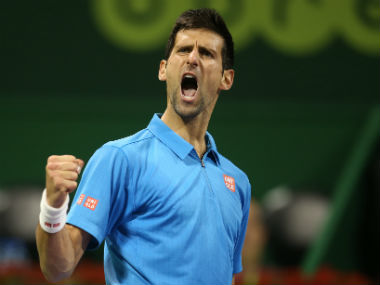 Novak Djokovic celebrates after winning a point in the final against Andy Murray. Getty Images