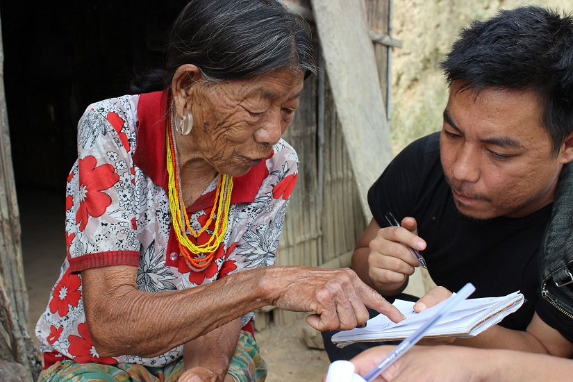 Recollecting history: Mo Naga learning from an old tattooed lady at Kiphire District, Nagaland