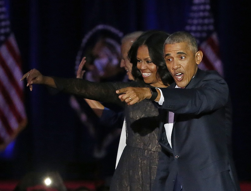 President Barack Obama waves as he is joined by First Lady Michelle Obama after giving his presidential farewell address at McCormick Place in Chicago, Tuesday, Jan. 10, 2017. (AP Photo/Charles Rex Arbogast)