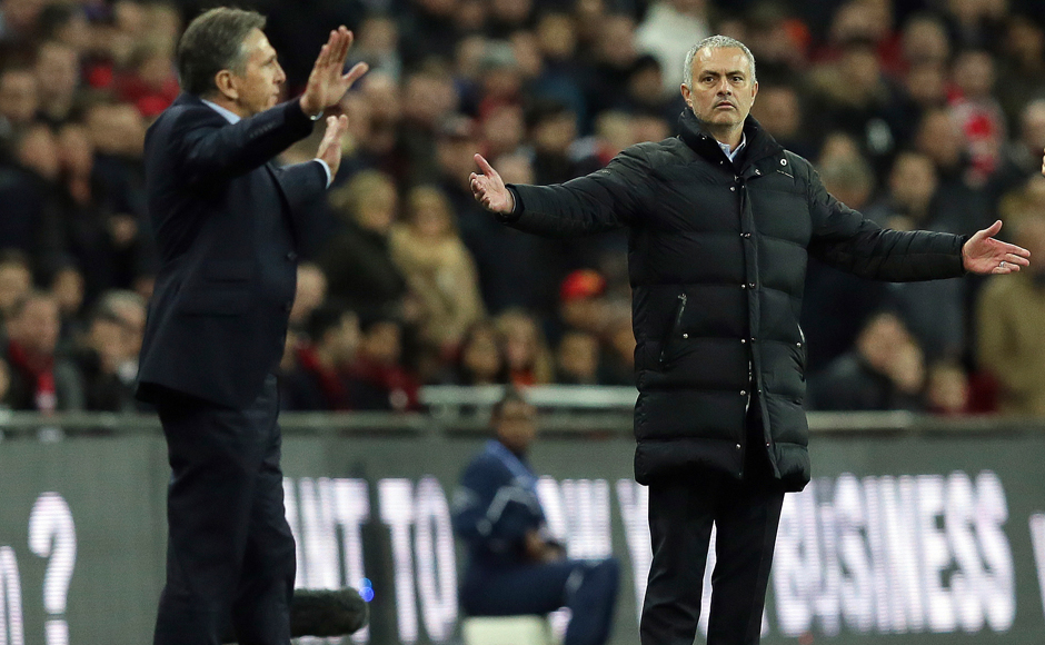 Southampton's manager Claude Puel, left, and Manchester United's manager Jose Mourinho gesture during the English League Cup final soccer match between Manchester United and Southampton FC at Wembley stadium in London, Sunday, Feb. 26, 2017. (AP Photo/Tim Ireland)