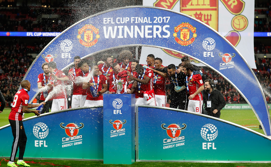"Britain Soccer Football - Southampton v Manchester United - EFL Cup Final - Wembley Stadium - 26/2/17 Manchester United players celebrate with the trophy at the end of the match Action Images via Reuters / Carl Recine Livepic EDITORIAL USE ONLY. No use with unauthorized audio, video, data, fixture lists, club/league logos or ""live"" services. Online in-match use limited to 45 images, no video emulation. No use in betting, games or single club/league/player publications. Please contact your account representative for further details."