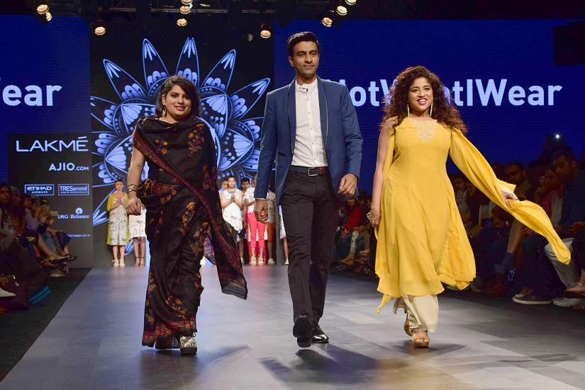Bollywood actors Mallika Dua, Varun Thakur and Malishka RJ display the creation of fashion brand #NotWhatIWear at the Lakme Fashion Week Summer/Resort 2017, in Mumbai, India on February 5, 2017. (Sanket Shinde/SOLARIS IMAGES)