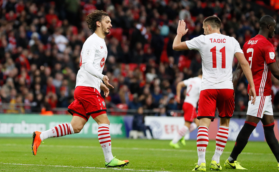 Southampton's Manolo Gabbiadini, left, celebrates after scoring his side's first goal during the English League Cup final soccer match between Manchester United and Southampton FC at Wembley stadium in London, Sunday, Feb. 26, 2017. (AP Photo/Kirsty Wigglesworth)