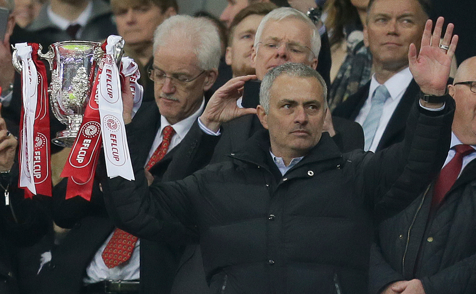 Manchester United's manager Jose Mourinho holds the trophy after his team won the English League Cup final soccer match between Manchester United and Southampton FC at Wembley stadium in London, Sunday, Feb. 26, 2017. (AP Photo/Tim Ireland)