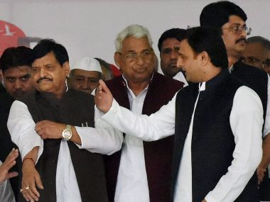 A file image of Chief Minister Akhilesh Yadav with uncle Shivpal. PTI