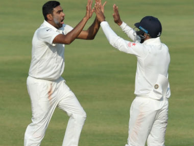 R Ashwin (L) celebrates the wicket of Bangladesh's Mominul Haque on Day 4 of the one-off Test in Hyderabad. AFP