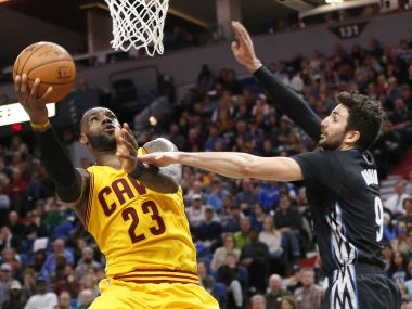 Cleveland Cavaliers' LeBron James, lays up as Minnesota Timberwolves' Ricky Rubio defends. AP