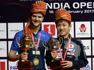 Dimitrij Ovtcharov of Germany (L) poses with the winning trophy along with runner-up Harimoto Tomokazu (R). AFP