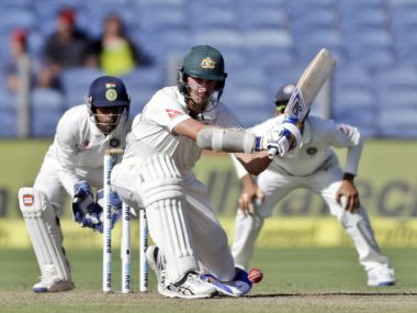 Australia's Mitchell Starc bats during the first day of the Pune Test against India. AP
