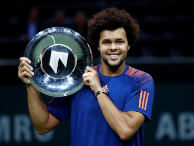 Jo-Wilfried Tsonga celebrates with the trophy after winning his match against David Goffin. Reuters