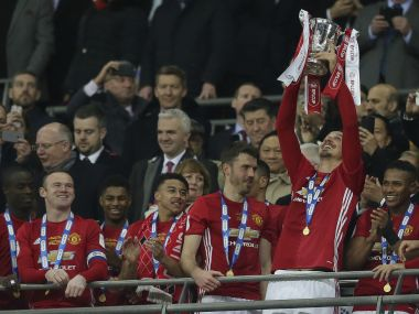Manchester United's Zlatan Ibrahimovic lifts the trophy after winning the League Cup final. AP