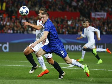 Leicester City's Jamie Vardy in action with Sevilla's Daniel Carrico. Reuters