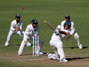 Australia's Mitchell Starc plays a shot on Day 1 of the Pune Test against India. Reuters