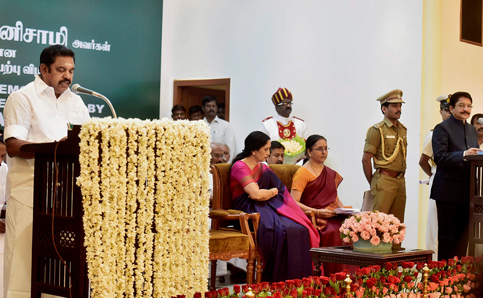 Chief Minister 'Edappadi' K Palaniswami taking the oath of secrecy administered by Governor CH Vidyasagar Rao during the swearing-in ceremony at Raj Bhavan in Chennai on Thursday. PTI Photo R Senthil Kumar(PTI2_16_2017_000176B)
