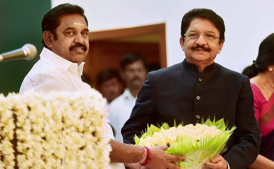 Chief Minister 'Edappadi' K Palaniswami being presenting a floral bouquet by Governor CH Vidyasagar Rao after he taking the oath as Chief Minister of Tamil Nadu during the swearing-in ceremony at Raj Bhavan in Chennai on Thursday. PTI Photo R Senthil Kumar(PTI2_16_2017_000213B)