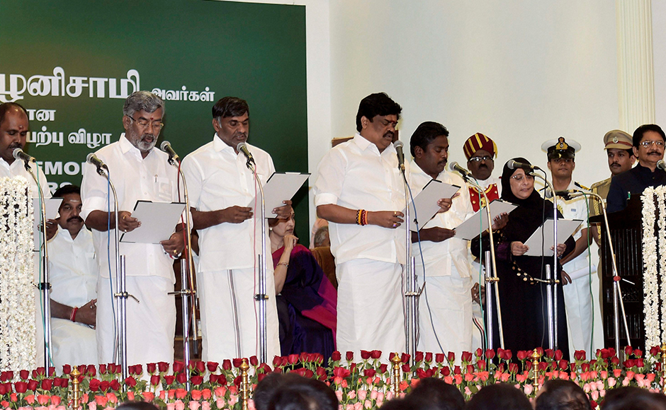 The Council of Ministers taking over the oath of secrecy following Chief Minister 'Edappadi' K Palaniswami during the swearing-in ceremony at Raj Bhavan in Chennai on Thursday. PTI Photo R Senthil Kumar(PTI2_16_2017_000235B)