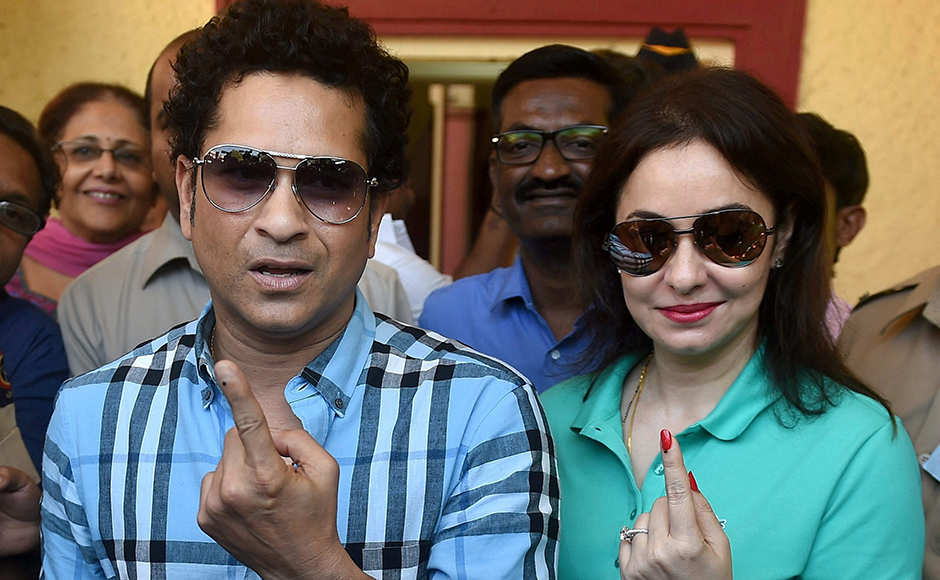 Cricket legend Sachin Tendulkar along with wife Anjali Tendulkar displays the indelible ink mark on their fingers after casting the vote for the municipal corporation election in Mumbai on Tuesday. PTI Photo by Mitesh Bhuvad(PTI2_21_2017_000054B)
