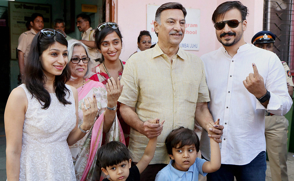 Bollywood actor Vivek Oberoi, along with his father Suresh Oberoi, mother, sister, wife and sons after casting their votes at Juhu in Mumbai on Tuesday. PTI Photo (PTI2_21_2017_000191B)