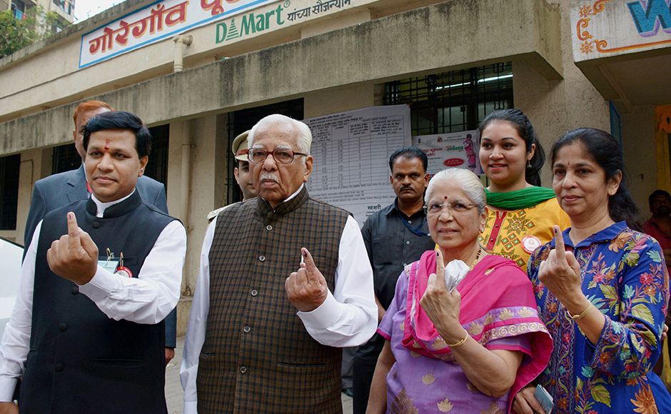 UP Governor Ram Naik (R) and his wife Kunda showing ink marked fingers after casting votes for Mumbai Corporation Election at Goregaon in North Mumbai on Tuesday. PTI Photo (PTI2_21_2017_000203B)
