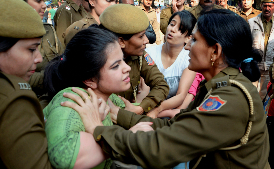 Police detaining ABVP activists after their clash with AISA students at Delhi University in Delhi on Wednesday. PTI Photo(PTI2_22_2017_000193B)
