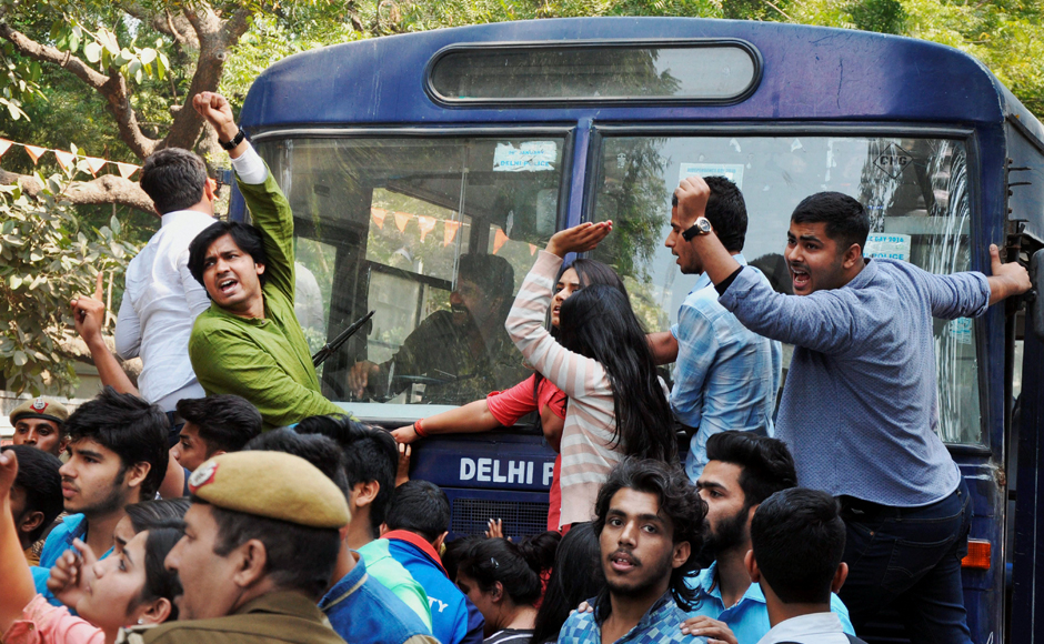 Police detaining ABVP activists after their clash with AISA students at Delhi University in Delhi on Wednesday. PTI Photo(PTI2_22_2017_000196B)