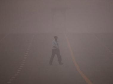 A man crosses a road amidst the heavy smog in New Delhi, India. Reuters