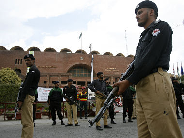 Lahore's Gaddafi stadium manned by security guards on the outside. Reuters