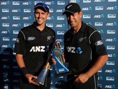 Trent Boult and Ross Taylor celebrate after the match.  AFP