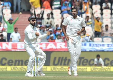 Virat Kohli (left) and Ravichandran Ashwin celebrate a Bangladesh wicket in the one-off Test in February 2017. AFP