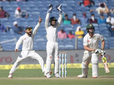 India's captain Virat Kohli (L) and Wriddhiman Saha appeal unsuccessfully against Australia's Mitchell Marsh. AFP