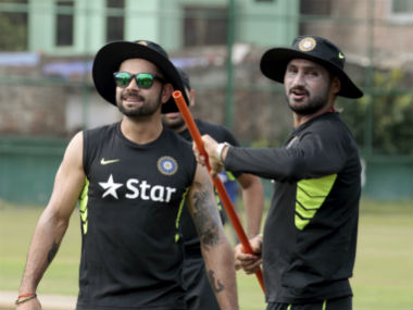 Virat Kohli and Harbhajan Singh. Reuters