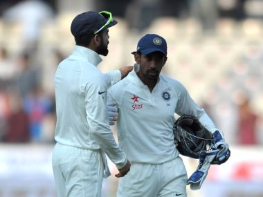 Virat Kohli (L) and Wriddhiman Saha. AFP
