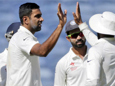 Ashwin (L) celebrates the dismissal of Australia's Matt Renshaw during Day 1 of 1st Test in Pune. AP