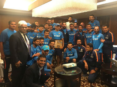 Dhoni was presented a unique memento by the Indian team. Image courtesy: Twitter/ @BCCI