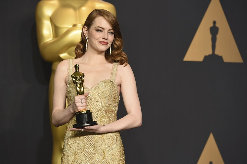 "Emma Stone poses in the press room with the award for best actress in a leading role for ""La La Land"" at the Oscars on Sunday, Feb. 26, 2017, at the Dolby Theatre in Los Angeles. (Photo by Jordan Strauss/Invision/AP)"