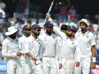 Virat Kohli and rest of the Indian team celebrate their win over Bangladesh in the one-off Test in Hyderabad. AFP