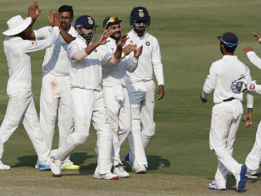 Indian players celebrate the dismissal of Mominul Haque on Day 4 of the one-off Test against Bangladesh. AP