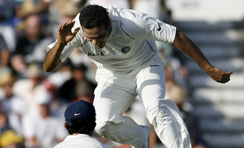 Irfan Pathan (top) celebrates the wicket of Australia's Phil Jaques during day three of the third Test against Australia in Perth in 2008. AFP