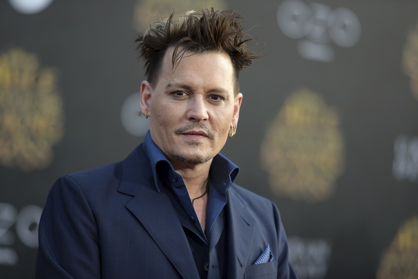 """FILE - In this May 23, 2016 file photo, Johnny Depp arrives at the premiere of """"Alice Through the Looking Glass"""" at the El Capitan Theatre, in Los Angeles. Johnny Depp is suing his former business managers alleging they mismanaged his earnings throughout his career, although the company says the actor's spending is to blame. Depp's lawsuit filed Friday, Jan. 13, 2017 in Los Angeles Superior Court against The Management Group seeks more than $25 million, alleging its owners failed to properly pay his taxes, made unauthorized loans and overpaid for security and other services, but the company's attorney says the managers tried for years to control Depp's spending. (Photo by Richard Shotwell/Invision/AP, File)"""