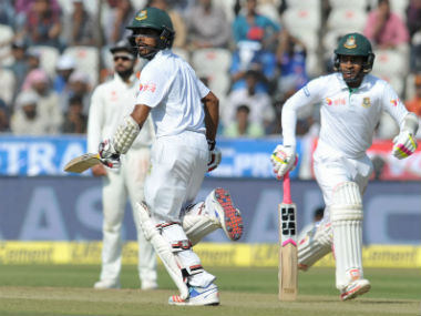 Bangladesh captain Mushfiqur Rahim (R) and Mehedi Hasan in action during the Hyderabad Test against India. AFP