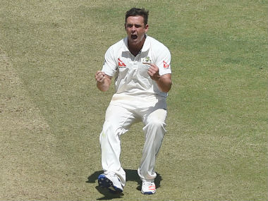 Steve O'Keefe celebrates the dismissal of Ajinkya Rahane on Day 2 of the first Test between India and Australia in Pune. AFP