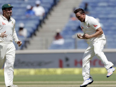 O'Keefe (R) celebrates the dismissal of Kohli during Day 3 of the Pune Test between India and Australia. AP