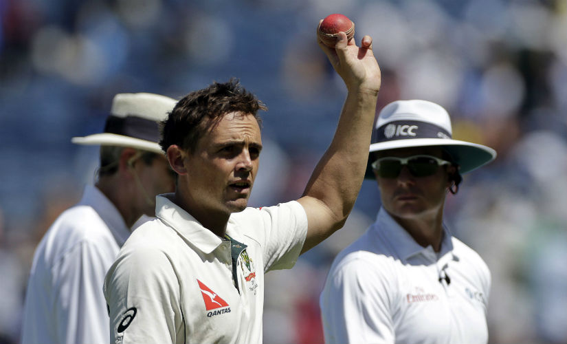 Steve O'Keefe celebrates his sixth wicket on the Day 2 of the first Test between India and Australia in Pune. AP
