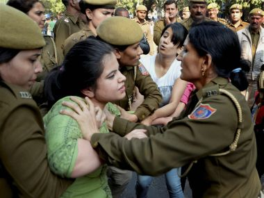 Police stop ABVP activists after their clash with AISA students at Delhi University. PTI