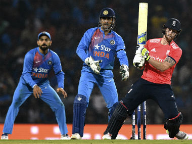 Ben Stokes plays a shot as Virat Kohli and MS Dhoni watch in the 2nd India vs England T20I in Nagpur. AFP