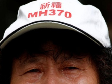 A family member of a passenger aboard Malaysia Airlines flight MH370 which went missing in 2014. Reuters