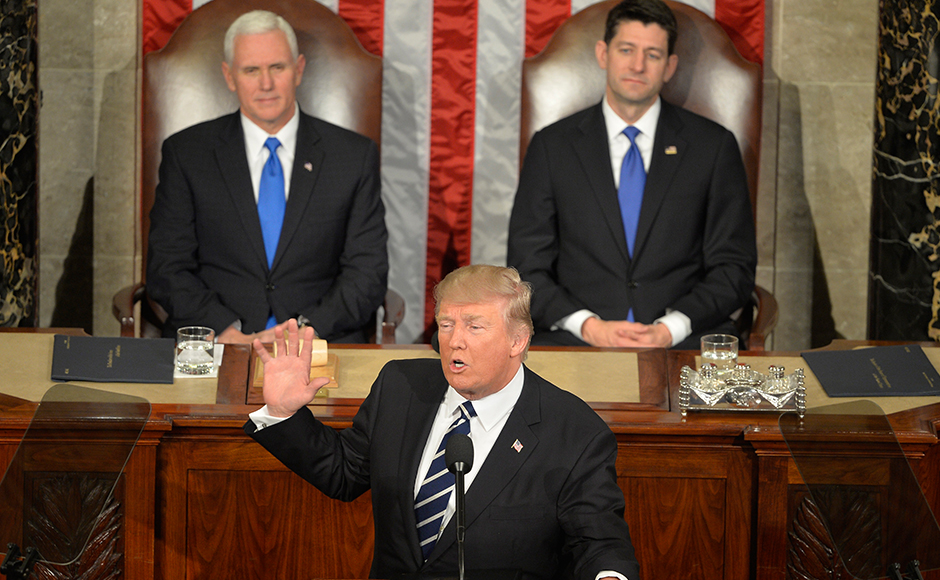 U.S. President Donald J. Trump (C) makes remarks during his address to a joint session of Congress, as Vice President Mike Pence (L) and House Speaker Paul Ryan listen, at the U.S. Capitol, in Washington, DC, February 28, 2017. Trump, in his first address to Congress, laid out his agenda on issues like immigration, the economy, foreign affairs and health care. Mike Theiler / AFP
