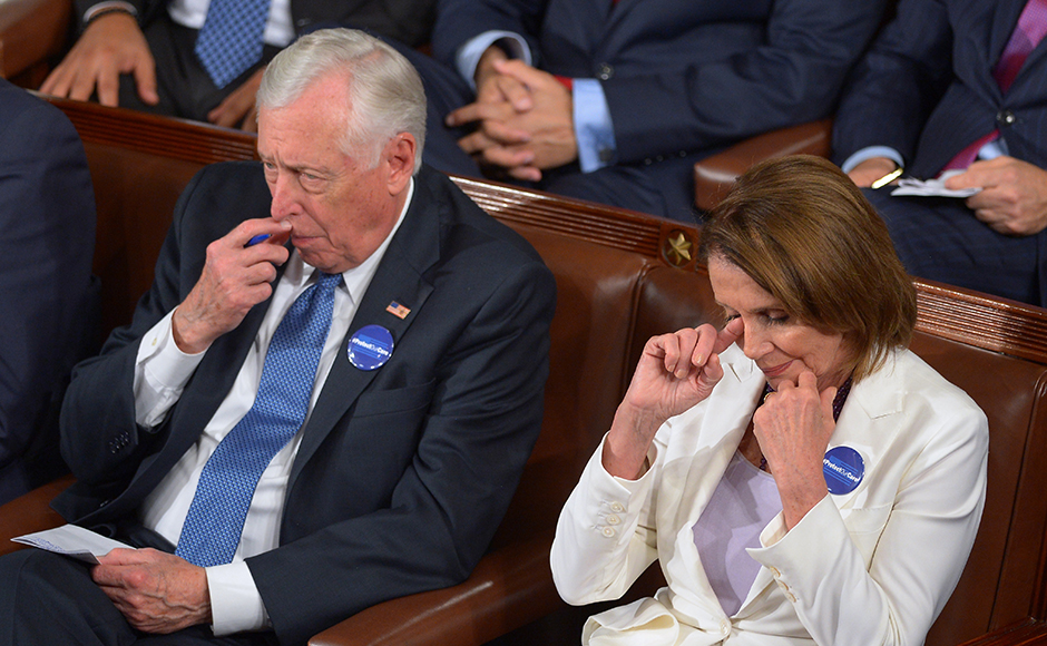 Minority Whip Rep Steny Hoyer (L), D-MD, and Minority Leader Rep Nancy Pelosi watch as US President Donald Trump addresses a joint session of Congress at the US Capitol in Washington, DC on February 28, 2017. MANDEL NGAN / AFP