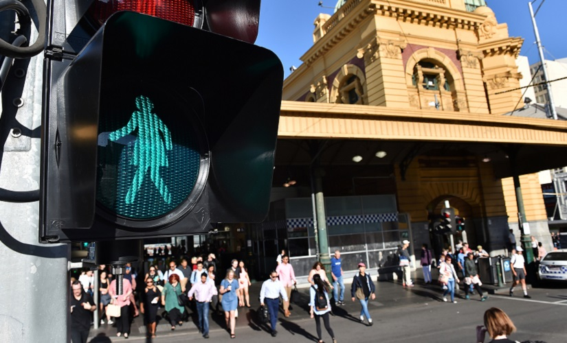 New traffic signals designed to equal the gender balance guide pedestrians on International Women's Day in Melbourne. AFP