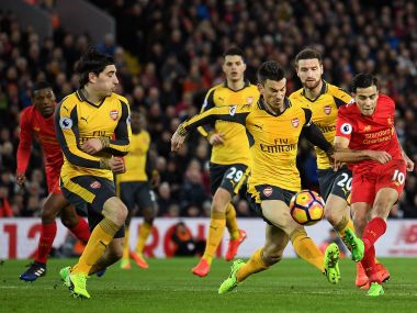Liverpool's (right) Philippe Coutinho of shoots while under pressure from Arsenal players. Getty Images